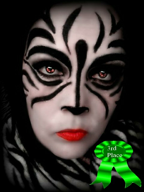 Womans face with Zebra make-up