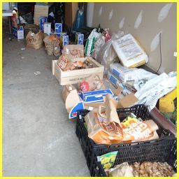 crates and boxes of brown paper bags lined up in garage